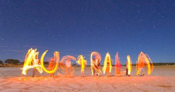 Writing with burning sticks in the air. Salt lake central Australia.